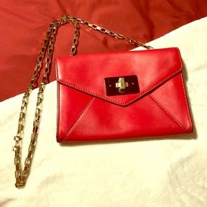 Kate space red crossbody clutch